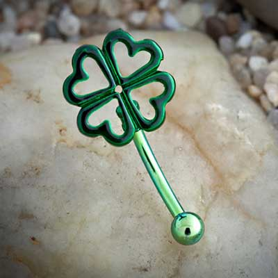 Green curved barbell with four leaf clover