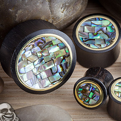 Arang wood plugs with abalone tile inlays