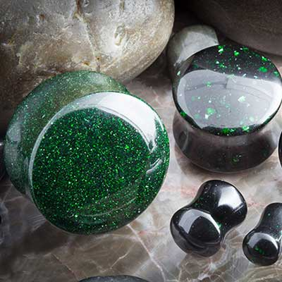 Double flare green goldstone plugs