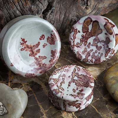 Concave red and grey picture jasper plugs
