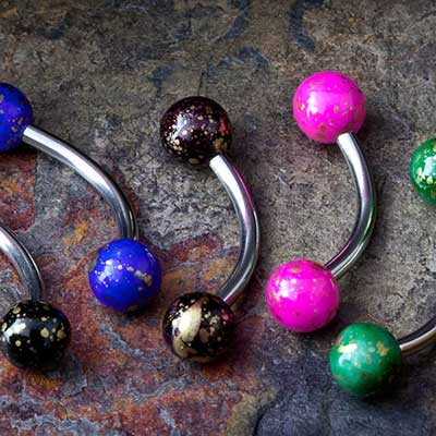 Steel curved barbell with fossil acrylic balls