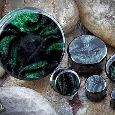 Double flare Borostone plugs (black/sparkle green)