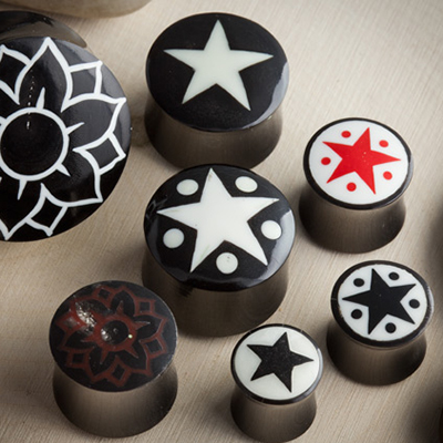 Blemished black horn plugs with inlays