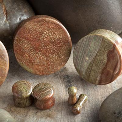 Wood jasper stone plugs