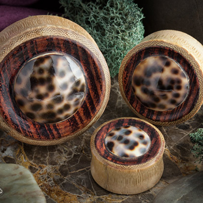 Bamboo plugs with tiger wood and shell inlays