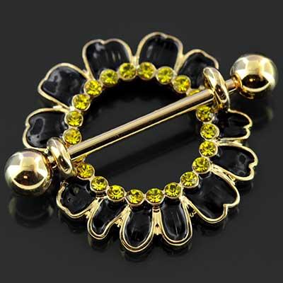 Gold colored black daisy nipple shield