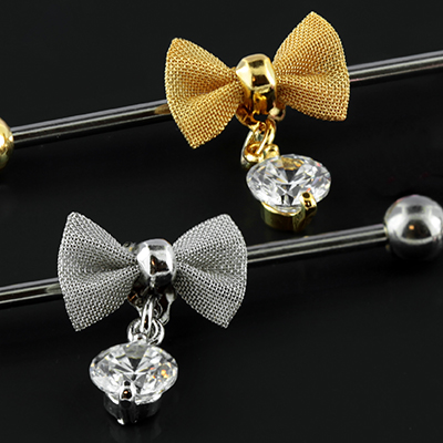 Bow with gem dangle industrial barbell
