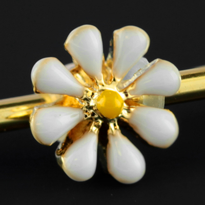 Gold colored daisy industrial barbell