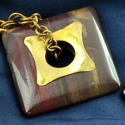 Solid brass and tiger iron square weights