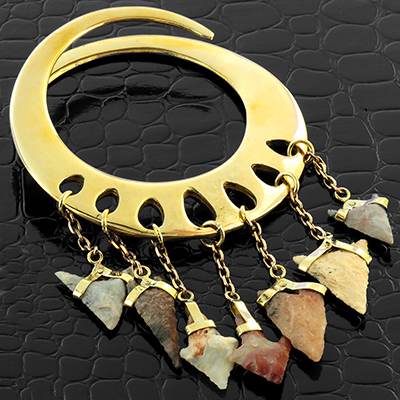 Solid brass hoops with neolithic arrowheads
