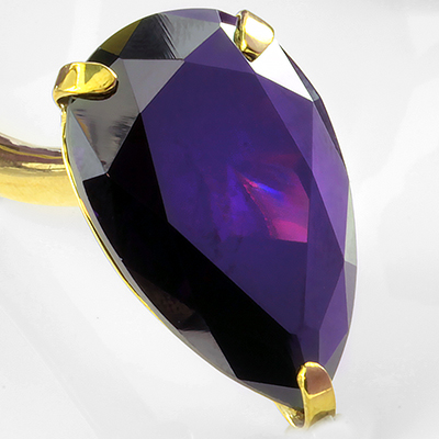 Solid brass Tsabit design with faceted purple glass