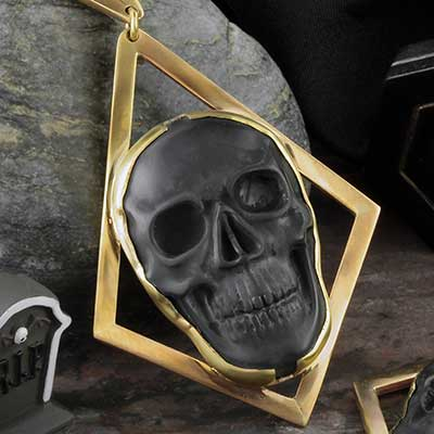 Solid brass and black onyx skull weights