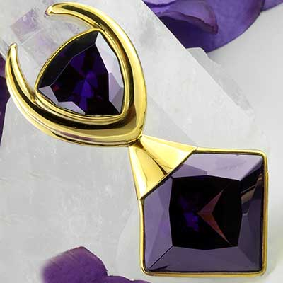 Solid brass with purple glass saddle weights