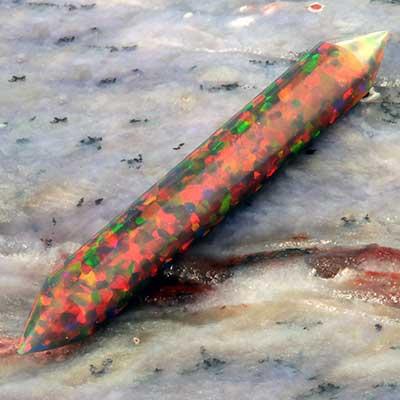 Synthetic opal septum spike