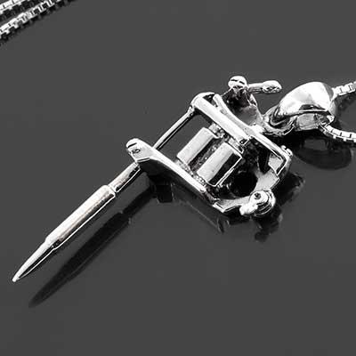 Silver tattoo gun necklace
