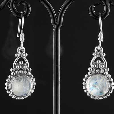 Silver and ornate moonstone earrings