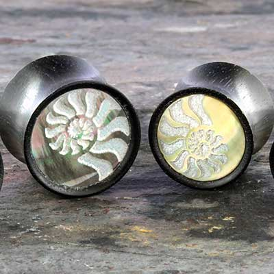 Arang wood plugs with abalone ammonite inlays