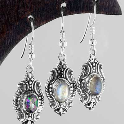 Silver ornate shield earrings