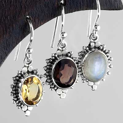 Silver ornate sunburst earrings