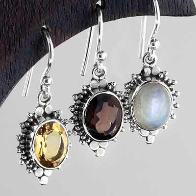 Silver ornate sunburst earrings