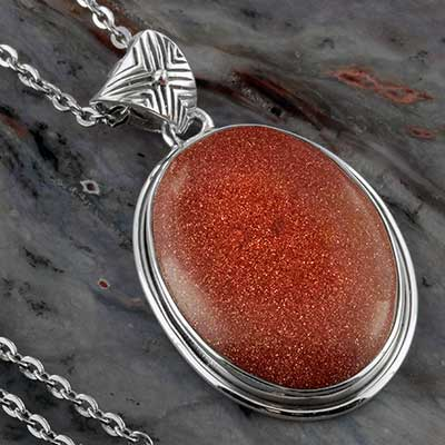 Goldstone and silver necklace