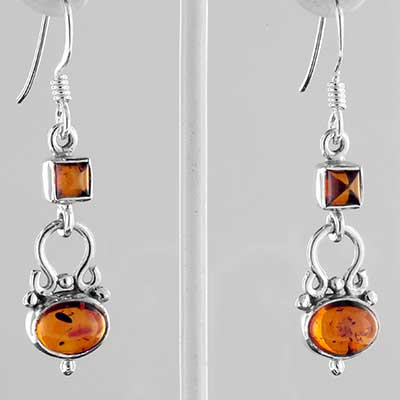 Silver and ornate amber earrings