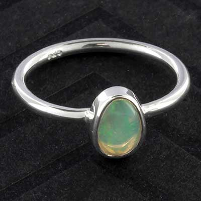 Silver and genuine opal ring