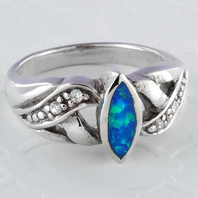 Silver and synthetic blue opal with CZ ring