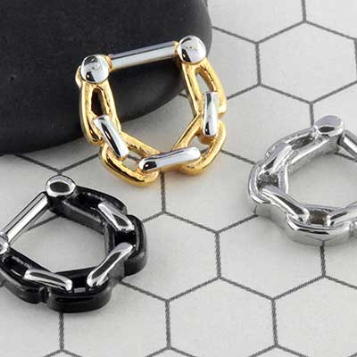 Chain link septum clicker