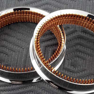 Steel eyelets with bronze bullet inlay