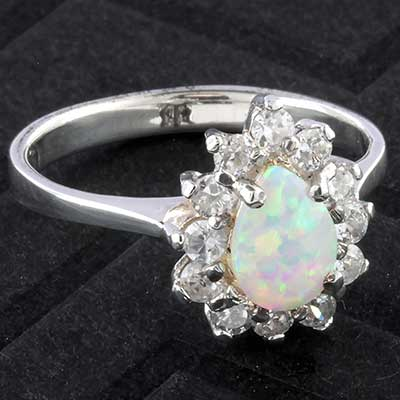 Silver and synthetic opal teardrop burst ring