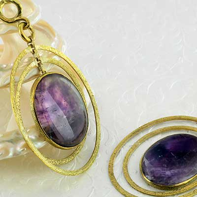 Hammered brass and amethyst movement weights