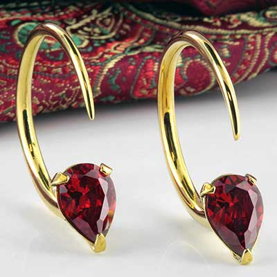 Solid brass Tsabit design with faceted red glass