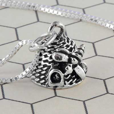 Silver beehive necklace