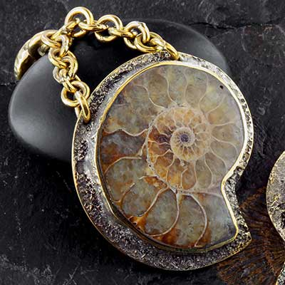 Hammered brass and ammonite dangles