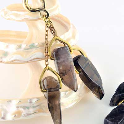 Solid brass and smokey quartz triplet weights