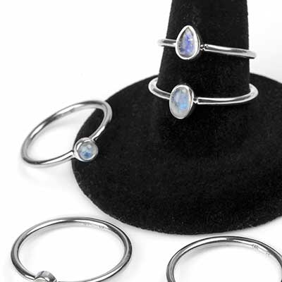 Silver and oval moonstone ring