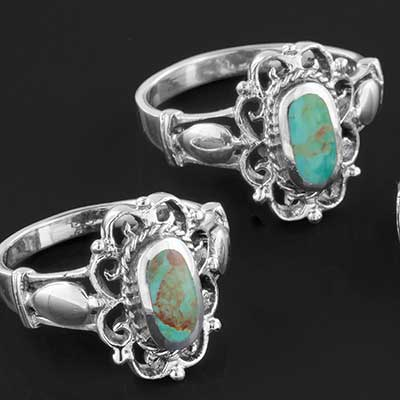 Silver and ornate turquoise ring
