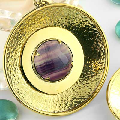 Solid brass with fluorite disc weights
