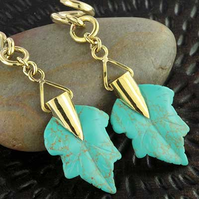 Solid brass and synthetic turquoise maple leaf weights