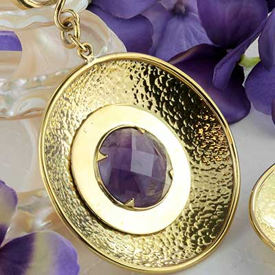 Solid brass with amethyst disc weights