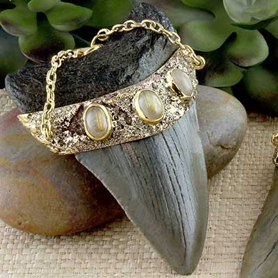 Solid brass and megalodon teeth weights with rutilated quartz