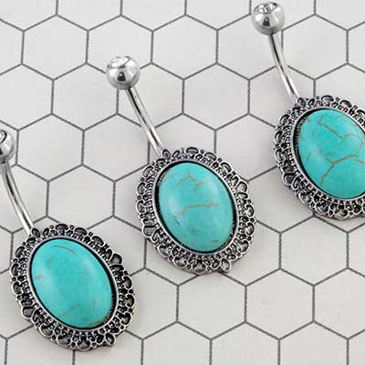 Framed synthetic turquoise oval navel