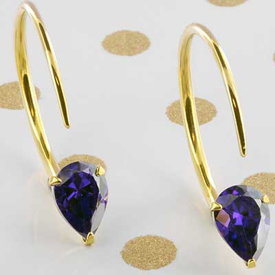 Solid brass small Tsabit design with faceted purple glass