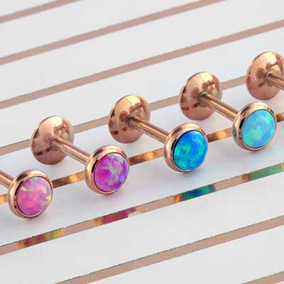 Rose gold titanium labret with synthetic opal