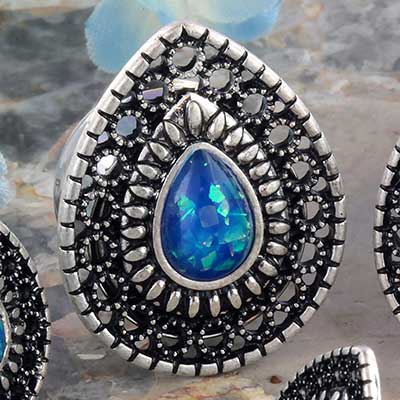 Synthetic blue opal ornate teardrop plug