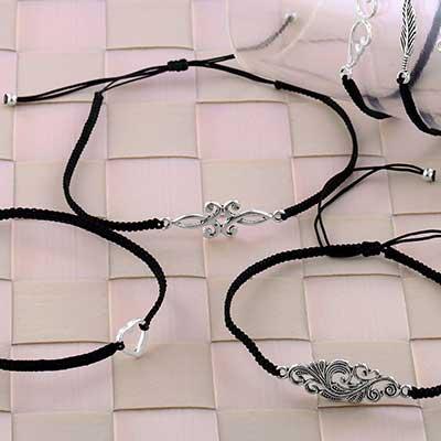 Petite Black Bracelet with Assorted Metal Design
