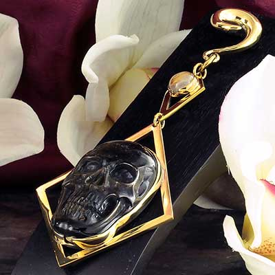 Brass and Golden Obsidian Skull with Rutilated Quartz Weights