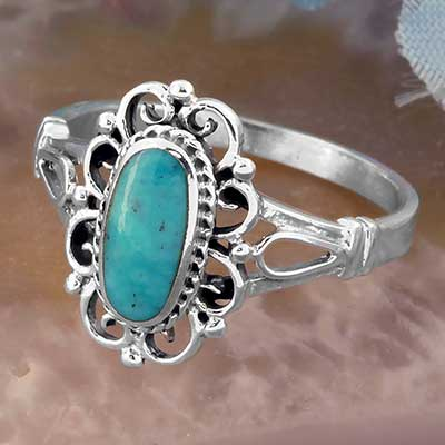 Silver and Ornate Framed Turquoise Ring