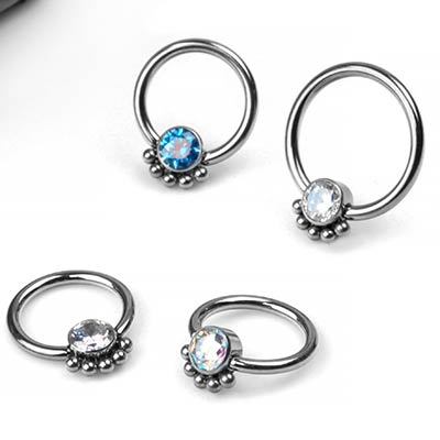 Titanium Captive Bead Ring With A Beaded Bezel Set Gem
